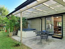 attached covered patio designs. Covered Patio With Plastic Roof : Practical Designs Attached