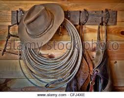 Cowboy Coat Rack Western tack and a cowboy hat on a coat rack Stock Photo 100 64