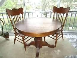 antique round oak table antique round oak table antique round oak table with pair pressed back antique round oak table