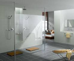 Here's a modern walk in shower design with a single glass wall and two  entry ways.