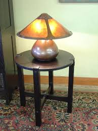 shown with aurora studios hand hammered copper and mica gourd lamp