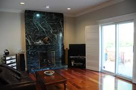stacked stones fireplace ideas displaying with black marble wall panels as decorate rustic fireplace ideas