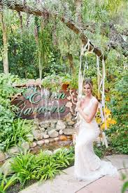 waterfalls at the entrance give a hint of what awaits at this paradise venue the bride looks delighted