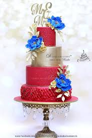 Red Gold Wedding Cake With Royal Blue Flowers Cakecentral Com