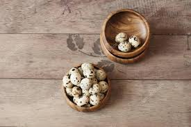 wooden bowls with quail eggs rustic wood background diffused natural light a diffe