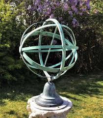 armillary sundial in antique garden