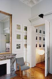 mirror above fireplace grey armchair