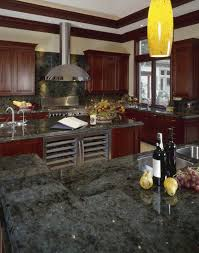 paint colors that look good with dark kitchen cabinets. rich dark green marble countertops and cherry wood fill this luxurious kitchen featuring brushed aluminum paint colors that look good with cabinets