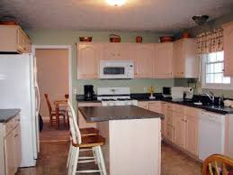 White kitchens and oak wood. Chic On A Shoestring Decorating Kitchen Before And After Featuring Glazed Antiqued Cabinets