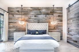 barn grey wood wall covering master bedroom
