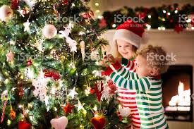 Kids Decorating Christmas Tree In Beautiful Living Room Stock Christmas Tree Kids