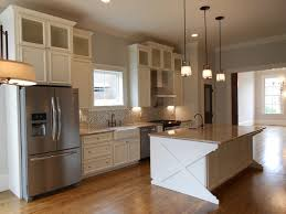 light gray antique kitchen appliances with frosted glass door kitchen cabinet and small window also mosaic kitchen backsplash facing marble countertop