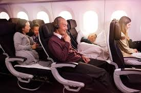 couple travelling on the air new zealand economy skycouch