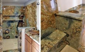 this custom bath project features full slab shower walls with matching bench seat and matching vanity