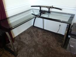 l shaped glass desk with stainless steel bases placed in the corner magnetizing