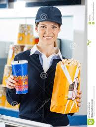 worker holding popcorn and drink at cinema stock photo image worker holding popcorn and drink at cinema