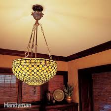 nothing spoils a dinner party like a chandelier in the pasta or a sudden blackout here s how to hang lights safely and securely