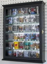 shot glass display product description display case made to hold regular size shot glasses shot glass