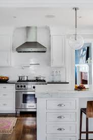 white glass subway tiles with wolf range