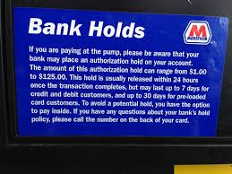 who puts that hold on your card when you pay at the pump the gas station or bank cleveland