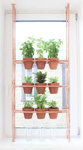 One of the best Hanging Herb Garden Ideas! A DIY copper rack is used to  make this pot holder, brilliant for small spaces.