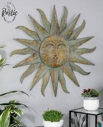 large metal sun wall decor bronze green