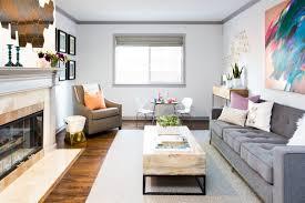 grey sofa beige area rug beige armchair contemporary artwork decorative pillows fireplace hearth geometric wall decor