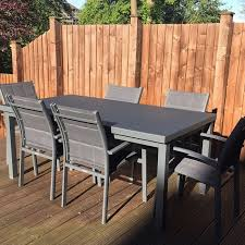 modern grey large automatic 6 seater extension dining table set metal glass top garden furniture 9