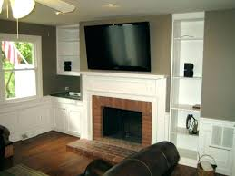 hanging what to hang above tv on barn door mounting gas fireplace how high mount flat