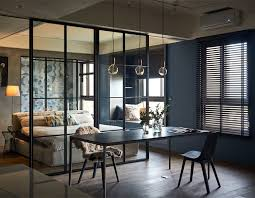 the suspended metal frames that can host pots with a fresh green plant life a very trendy design element yes this urban dwelling definitely overs multiple