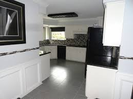 modern kitchen with black and white plan painting tile floors kitchen