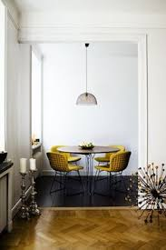 presuming this is a dining living room but it could be in the kitchen too the pop of yellow and the round table is very sixties