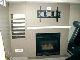 tv over fireplace where to put components concealed over fireplace mounting a above a gas fireplace