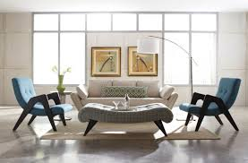 astonishing mid century modern living room featuring white sofa and blue chairs plus curved coffee table ottoman and white floor lamp