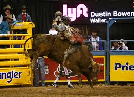Dustin Bowen of Waller, Texas rides Double Down in the bull riding  competition during the eighth go-round of the National Finals Rodeo,  Thursday, Dec. 14, 2017, at the Thomas & Mack Center