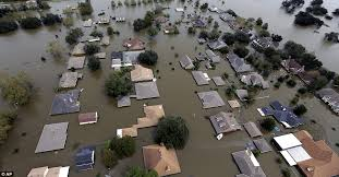 Image result for floods up to the rooftops of homes