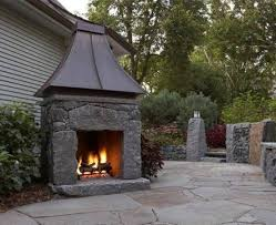 grab stone outdoor fireplace design with metal chimney picture