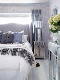bedroom with mirrored furniture. Bedroom With Gray Headboard, Mirrored Furniture And Menswear Pillows