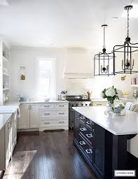 french kitchen lighting. An Open Concept Kitchen With Counter To Ceiling Subway Tile No Upper Cabinets And Mixed French Lighting