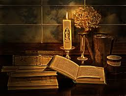 old books and candle by guna andersone boundary bleed area may not be visible