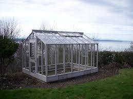 image of large glass greenhouse kits