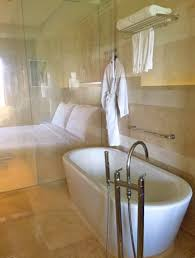 the marble bathroom features a toilet with bidet spray bathtub with jets rain shower and thann natural aromatherapy s from thailand