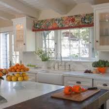 Traditional White Kitchen Boasts Orange Accents