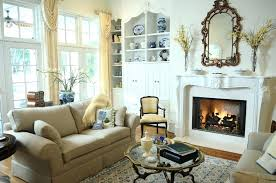 a small living room with an ornate fireplace mantle and screened wood burning traditional sitting rooms