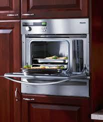 open oven in kitchen. dark-kitchen-dg-open.jpg dg155 convection steam oven open in kitchen