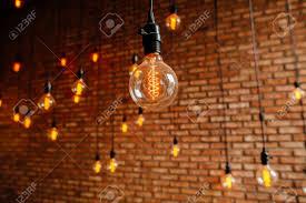 Image Vintage Light Bulb Edison Filament Retro Vintage Decore On Brick Wall Background Lighting Decoration Stock Photo 123rfcom Light Bulb Edison Filament Retro Vintage Decore On Brick Wall