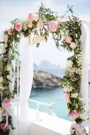 floral arches for weddings. pink and ivory flowers for wrapping the wedding arch floral arches weddings