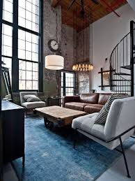 small industrial living room with brown leather sofa and grey single sofa