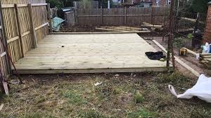 new landscaping job in exeter new garden patio decking area installed and turfing