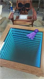 diy infinity mirror coffee table it may look like a regular coffee table but what this